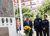 Dallas Mayor Eric Johnson, left, DART Police Chief James D. Spiller, and Dallas Police Chief U. Renee Hall watch during an unveiling ceremony for a memorial in honor of the five officers who died on July 7, 2016 at the Jack Evans Police Headquarters in Dallas on Monday, July 8, 2019.(Ryan Michalesko/Staff Photographer)