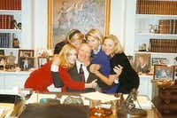 Daughters Katherine Reeves, Suzanne McGee, Nancy Perot and Carolyn Rathjen hug Ross Perot in his office in 1996.(Ross Perot family)