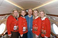"""<p><span style=""""font-size: 1em; background-color: transparent;"""">Ross Perot is surrounded by daughters (from left) Suzanne McGee, Nancy Perot, Katherine Reeves and Carolyn Rathjen wearing light-up Christmas sweaters that their dad bought at Dougherty's Pharmacy in 2007.</span></p>(Ross Perot family)"""