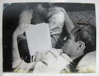 A curled-up Timothy Leary turns his attention to the written word in 1961.<br>(AP/New York Public Library, Manuscripts and Archives Division<br>)