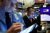Traders work on the floor of the New York Stock Exchange. in May. Don't buy stocks just because an analyst recommends it, the Fool says.(Richard Drew/The Associated Press)