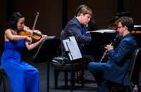 Violinist Grace Kang Wollett, pianist Mikhail Berestnev and clarinetist Danny Goldman rehearse before a Basically Beethoven Festival concert on July 7, 2019 at Moody Performance Hall in Dallas.(Ashley Landis/Staff Photographer)