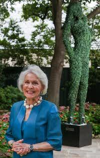 Linda Pitts Custard poses next to her gag gift from Ross Perot.(Ryan Michalesko/Staff Photographer)