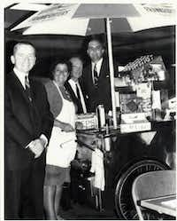 """Ross Perot, left, with New York City hot dog vendor Rudy Smutny and Ken Langone, who was with the brokerage firm, R. W. Pressprich, that handled the EDS's first public offering in 1968. Langone hired the hot dog stand for EDS' """"big"""" IPO luncheon, telling Perot that they were going to the """"exclusive"""" Umbrella Club. .(Ken Langone)"""