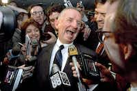 "This May 5, 1992 file photo shows Texas billionaire Ross Perot laughing after saying ""Watch my lips,"" in response to reporters asking when he plans to formally enter the presidential race. Perot, the colorful, self-made Texas billionaire who twice ran for president as a third-party candidate, has died. He was 89. (RICHARD DREW/AP)"