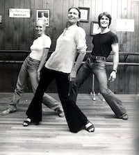 Patrick Swayze, right, dances with his mother Patsy Swayze, center, and his wife Lisa Niemi at Patsy Swayze's dance studio in Houston in June 1978.<br>(Tom Colburn/AP)
