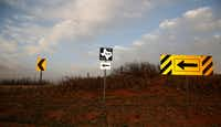 Directional signs point north where FM 168 begins at the junction with FM 1076 in Terry County west of Lubbock on April 17, 2018. (File Photo/Staff)