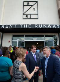 Arlington Mayor Pro-Tem Victoria Farrar-Myers, left, shakes hands with Rent The Runway chief operating officer Marv Cunningham as Arlington Mayor Jeff looks on at the company's new facility in Arlington.(Robert W. Hart/Special Contributor)
