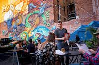Customers sit on the back patio of the Paramount Ballroom, one of the more hip places to be in Cheyenne, Wyo.(Autumn Parry/The Washington Post)