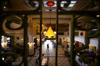 Guests walk through the two-story lobby of the Plains Hotel, the world's first to have telephones in every room, in Cheyenne, Wyo.(Autumn Parry/The Washington Post)