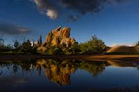 Rock formations are reflected in water after a storm near Vedauwoo Recreation Area near Cheyenne, Wyo.(Autumn Parry/The Washington Post)