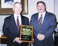 "<p><span style=""font-size: 1em; background-color: transparent;"">Ross Perot (left) is presented with a plaque by special agent Joseph Gutheinz (right) honoring him for his contribution to Operation Lunar Eclipse.</span><br></p>(Courtesy of Joseph Gutheinz)"