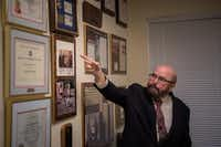 "Joseph Gutheinz, an attorney known as the ""Moon Rock Hunter,"" points to plaques in his office in Friendswood, Texas.(Loren Elliott/Agence France-Presse)"