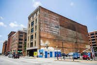 The outside of the historic Purse Building on Wednesday, July 10, 2019 in downtown Dallas. The old sign on the building's side dates back to its time it housed Purse & Co. Wholesale Furniture.(Ashley Landis/Staff Photographer)