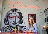 """Tanya Ragan, owner and president of Wildcat Management, at the Purse Building. Prominently featured near the front of the building is a floor-to-ceiling mural of urbanist activist Jane Jacobs and her mantra """"New ideas need old buildings.""""(Ashley Landis/Staff Photographer)"""