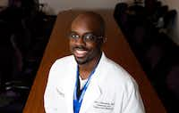 Dr. Dale Okorodudu is working to increase the number of black men in medicine through his work and brand, Black Men in White Coats.(Vernon Bryant/Staff Photographer)