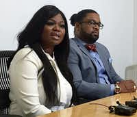 """Zonya Robinson, 36, discusses what she describes as a """"traumatic"""" Uber driving experience alongside her attorney, Larry Taylor, on Monday morning.(Emma Ruby/Staff)"""