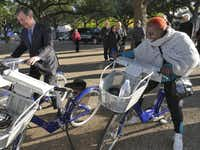 Then-Dallas Mayor Mike Rawlings, left, and then-City Council member Carolyn Davis debuted Fair Park's bike-share program station on Nov. 13, 2014.(FIle Photo/Staff)