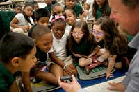 Second graders reacted as Geoff Gray of Primal Gardens shows them a photo of a large fish he uses in his hydroponics farm during a healthy food demonstration at Dallas ISD's N.W. Harllee Early Childhood Center in May.(Rose Baca/Staff Photographer)