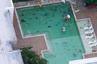 "<p>Debris lies in the swimming pool after a tower crane fell from a construction site into Elan City Lights apartments in Dallas.&nbsp;<span style=""font-size: 1em; background-color: transparent;""><p>&nbsp;Kiersten Smith, 29, who lived at the complex, was killed when the crane collapsed.&nbsp;&nbsp;<span style=""font-size: 1em; background-color: transparent;"">Five other people were hurt in the collapse, including two who were critically injured.</span></p></span></p>(Shaban Athuman/Staff Photographer)"