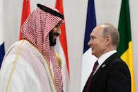 Saudi Arabia's crown prince, Mohammed bin Salman (left), talked with Russian President Vladimir Putin before the start of a G20 summit event in Osaka, Japan, on June 28.(Susan Walsh/The Associated Press)