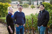 Margaret and Joe Valenzuela (at left), the owners of Rubia Wine Cellars, stand in one of the Napa Valley vineyards of Julien Fayard, their winemaker.(Suzanne Becker Bronk)