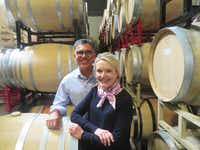 Joe and Margaret Valenzuela check out some of Rubia's wine aging in barrels at their winemaker Julien Fayard's property in Napa.(Sheryl Jean/Special Contributor)