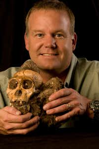 Wits University's Rising Star Expedition leader, Lee Berger, holds the fossil of an Australopithecus sediba individual.(Brett Eloff)