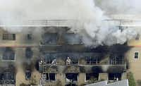 Firefighters work as smoke billows from a three-story building of Kyoto Animation in a fire in Kyoto, western Japan, Thursday, July 18, 2019.(AP)