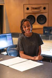Damoyee Janai Neroes working on the composition that will provide the new music that accompanies the ascent of the chandelier at the Winspear Opera House.(Carter Rose/AT&T Performing Arts Center)