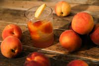 A peach cocktail with rum and ginger July 10, 2019 in The Dallas Morning News Test Kitchen in Dallas.(Ryan Michalesko/Staff Photographer)