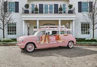 Rosewood Miramar Beach totes guests around in a pink vehicle topped with a surfboard.(Rosewood Miramar Beach)