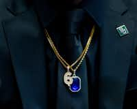 Baylor running back JaMycal Hasty wore double necklaces, one with his football number and another with a blue sapphire birthstone pendant for his birth month, September.(Lynda M. Gonzalez/Staff Photographer)