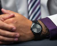Trey Dishon, defensive tackle for Kansas State University, wears a Michael Kors watch during the Big 12 Conference Media Days event at the AT&T Stadium in Arlington on July 16, 2019.(Lynda M. Gonzalez/Staff Photographer)
