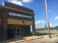 The building that once housed the Enloe State Bank. Today, the empty building sits on the corner of a stretch of empty storefronts.(Orla McCaffrey/Staff)