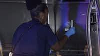 Investigators examine the victim's pickup.<br>(Metro Video Dallas/Fort Worth<br>)