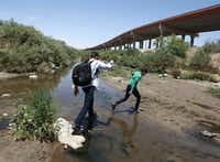 People cross the Rio Grande into the United States to turn themselves over to authorities and ask for asylum on June 7, as seen from Ciudad Juarez, Chihuahua, Mexico, opposite El Paso.(Christian Torres/AP)