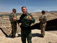Aaron Hull, Border Patrol Chief of the El Paso sector, answers questions along the border fence in Sunland Park, New Mexico, on July 18th.(Alfredo Corchado/The Dallas Morning News)