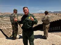 "<p><span style=""font-size: 1em; background-color: transparent;"">Aaron Hull, Border Patrol chief of the El Paso sector, answered questions along the border fence in Sunland Park, N.M., last week.&nbsp;</span></p>(Alfredo Corchado/Staff)"