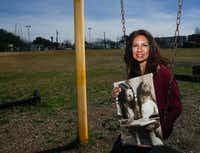 Maria Lozada Garcia, 51, La Bajada Neighborhood Community Association president, holds a photograph from when she was in preschool, being taught to read by a woman named Julia. Lozado Garcia said she cannot remember Julia's last name.(Daniel Carde/The Dallas Morning News)