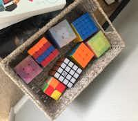 Helen Hoang keeps a box of Rubik's-style cubes at her house.(Lisa Bonos/The Washington Post)
