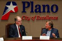 Plano Mayor Pro Tem Rick Smith (left) listened Monday night as Planning and Zoning Commission Chair John Muns explained why his group didn't have sufficient information to take a vote on changing the city's master development plan.(Ryan Michalesko/Staff Photographer)