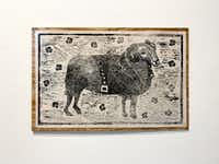 "<p>Angela Faz's <i>Black Ram With Pansies</i>, a 2019 relief woodcut carved from plywood, references the&nbsp;<span style=""font-size: 1em; background-color: transparent;"">gay slur ""pansy"" by portraying a ram in a leather jacket on a field of black pansies. The work turns the insult into an image of strength.</span></p>(Nan Coulter/Special Contributor)"