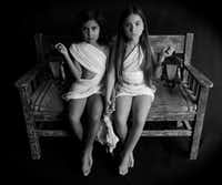 Leticia Alaniz' <i>Dos Ni As (Two Girls)</i>, a 2019 silver gelatin print on museum-quality paper, is displayed at the exhibition.(Nan Coulter/Special Contributor)