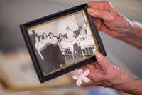 Hilda Tinker Rautenberg goes through a picture of her United Service Organizations trip at Mustang Creek Estates in Keller.&nbsp; <br>(Shaban Athuman/Staff Photographer)