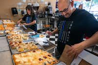 Kasa Kolache bakery owners Enrique Barrera (right) and Gloria Barrera prepare a kolache order for customers in Coppell, Texas, on Thursday, July 25, 2019. (Lynda M. Gonzalez/The Dallas Morning News)(Lynda M. Gonzalez/Staff Photographer)