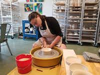 Instructor Emily Davis demonstrates pottery-making techniques at Blackberry Mountain.(Wesley K.H. Teo/Special Contributor)