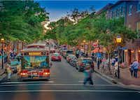 A trolley rolls down King Street, a popular stretch of Alexandria with more than 160 shops and restaurants. Most are along a 1-mile stretch near the Potomac River waterfront.(R. Kennedy/Visit Alexandria)