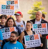 <p>City Council member Adam Medrano (right) held a sign during a June 2018 news conference before a coalition of labor and faith groups and political activists delivered petitions to City Hall calling for a city ordinance mandating paid sick time to be placed on last November's ballot. The petition drive failed, but Medrano and his council colleagues passed an ordinance in April.</p>(Smiley N. Pool/Staff Photographer)