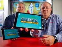 Southern Methodist University  professors Corey Clark (left) and Tony Cuevas were part of the SMU-LIFT team, PeopleforWords, that won $1.5 million as a grand prize winner for a video game app, Codex: The Lost Words of Atlantis. The two are photographed in a lab on campus, Wednesday, July 10, 2019.(Tom Fox/Staff Photographer)